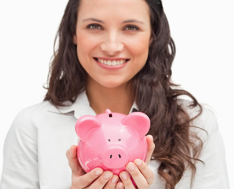 smiling woman holding a piggy bank